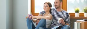 Couple Sitting Inside Home After Closing