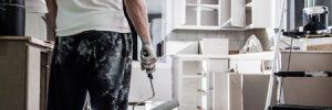 Man Painting Modern Kitchen