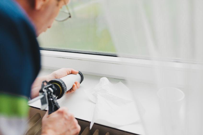 Man Repairing Window